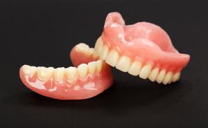 A set of dentures on a black background